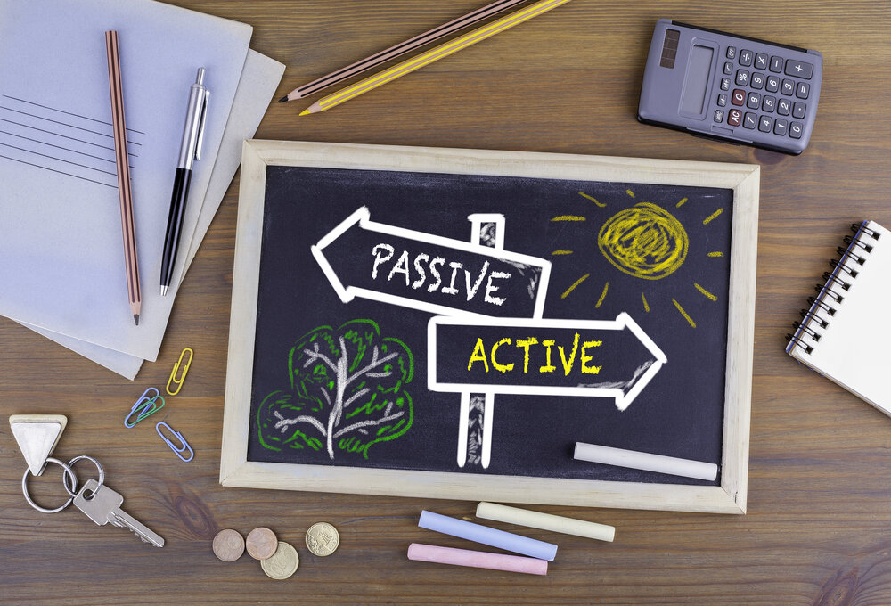 The words active and passive written on two signs